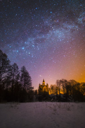 Old catholic church under starry sky