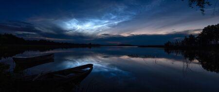 Rare meteorological phenomenon - bright noctilucent clouds (night shining clouds) Foto de archivo