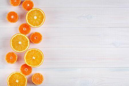Orange citrus fruits on white wooden background Archivio Fotografico