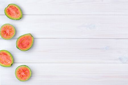 Guava fruits isolated on white wooden background Archivio Fotografico