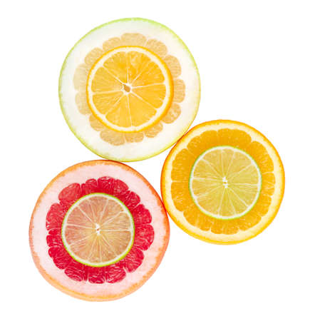 Colorful citrus slices isolated on white background