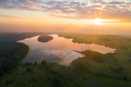 Foggy morning at beautiful lake in Belarus