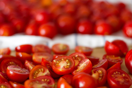 Cherry tomatoes on a kitchen white towel, in a cut. 스톡 콘텐츠