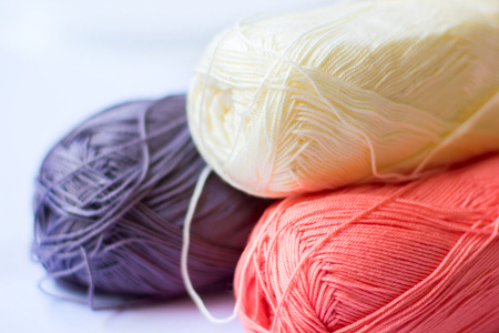 Color yarn made of fine yarn on a light background for handwork