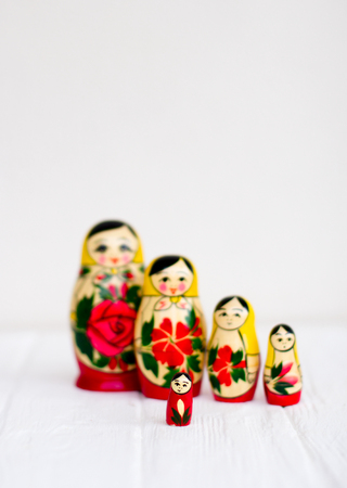 Russian national nesting dolls on a white background Фото со стока