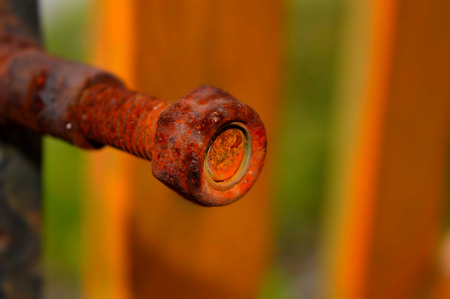 close up picture of old rusted bolt