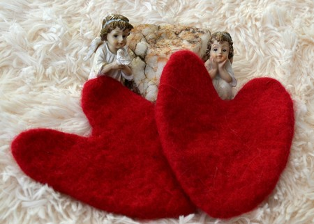 valentines day with angels and white stone on a soft white blanket Stock Photo