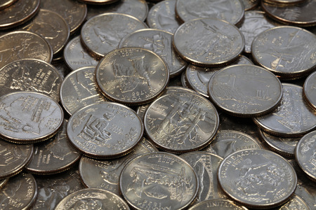 five cents: close view of twenty five cents coins Stock Photo