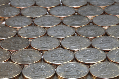25 cents: close view of twenty five cents coins Stock Photo