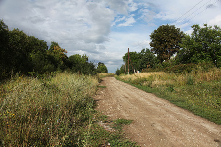 unsurfaced road: dirt road Stock Photo