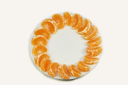 peeled tangerines on a plate
