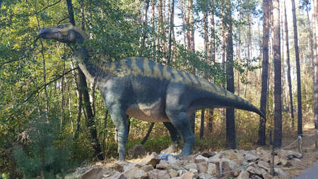 Iguanodon - a herbivorous dinosaur from Europe. They lived and ate the herd. Their lives took place near small bodies of water, which were surrounded by dense thickets of trees.