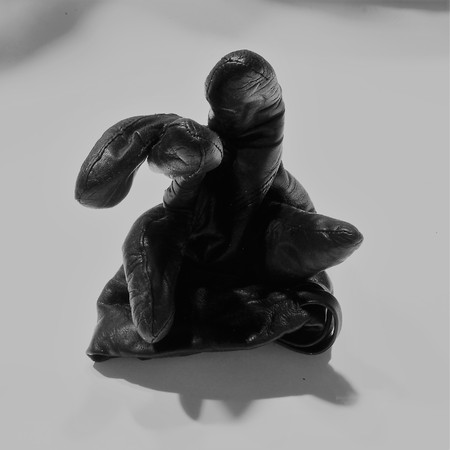 Black woven fabric. Futuristic gloss black matter. Black woven cloth monster on a white background. Black woven cloth on a white background. Black woven fabric in green tones on a white background. Black woven cloth monster Kruger on a white background.