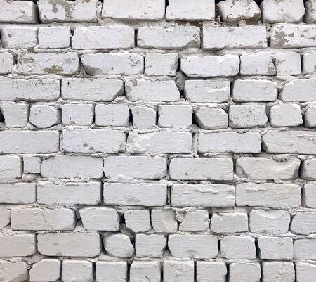 Old white grunge brick wall background