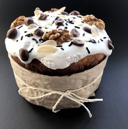 Easter cake with peanuts and nuts on black background