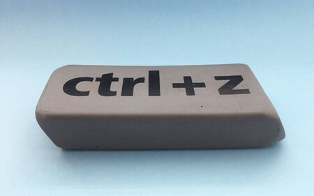eraser with the inscription ctrl + z on a blue background