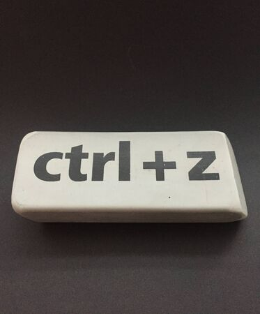 eraser with the inscription ctrl + z on a black background