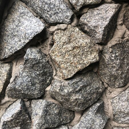 Natural old stone wall texture for background