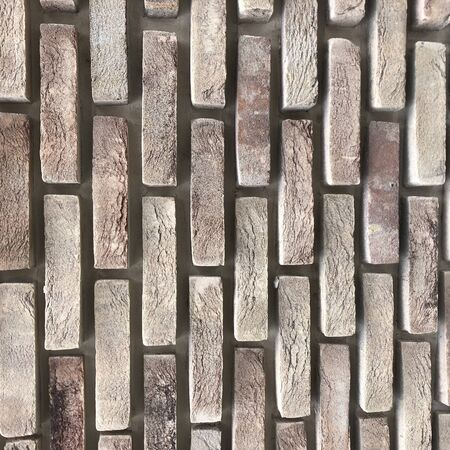 Wide Beige brick wall background texture. Home and office design backdrop Banco de Imagens