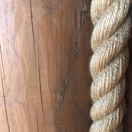 Image of wooden boards with ship rope
