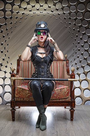 Portrait of a beautiful steampunk girl sitting in a chair