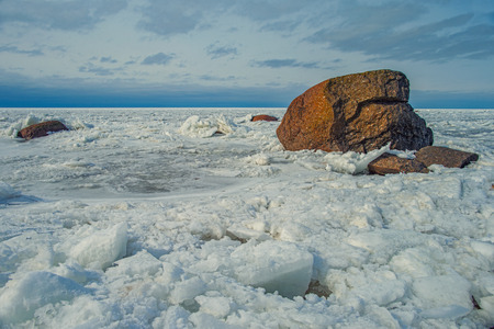 Ice hummocks and granite stones of the glacial period in the Gulf of Finland Stock Photo