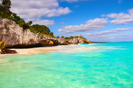 The sandy beach of Tulum at the foot of the rocky coast of the Yucatan Peninsula