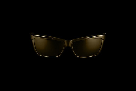 Gold-plated classic sunglasses wayfarer, close-up on a black background