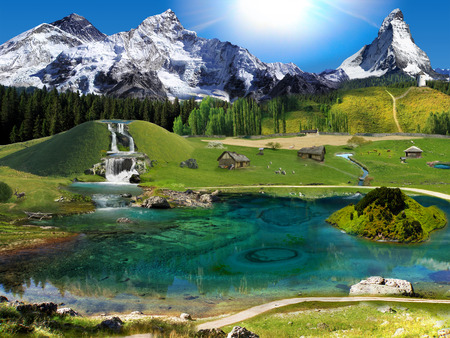 Mountain village settlement. Sunny morning. Waterfalls, ponds and a lake.