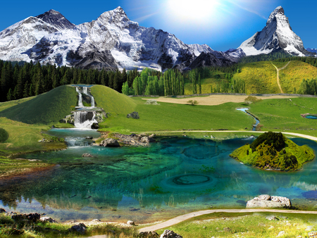 Panorama of the mountain nature. Green fields, mountains, lakes and waterfalls