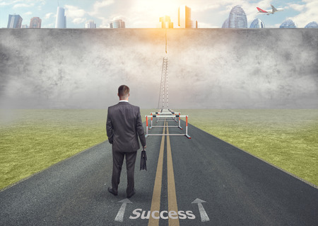 The businessman stopped in front of a difficult obstacle. Reflections before action.