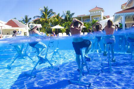 Punta Cana, Dominican Republic - Dec. 12, 2018: hotel Grand Bahia Principe Aquamarine, aqua aerobics on bikes Editorial