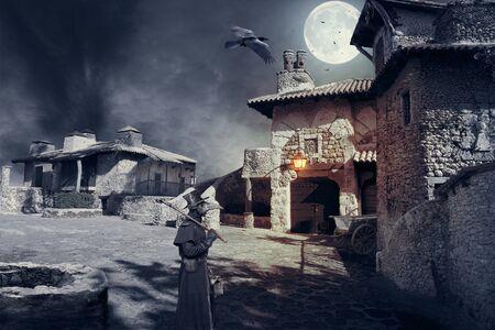 Epidemic of plague. Plague doctor in a medieval town. Foto de archivo