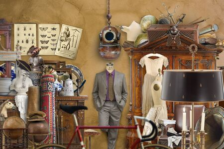Antiques, furniture and clothing in the light of burning candles. Stok Fotoğraf