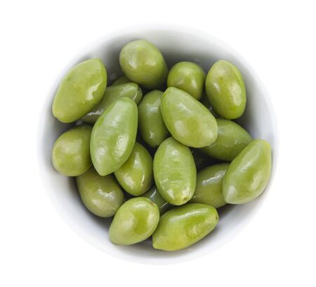 Large olives with cuttings in a porcelain bowl. Top view close up.