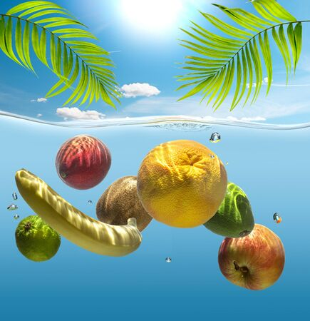 Ripe tropical fruits in the water, illuminated by bright sunlight.