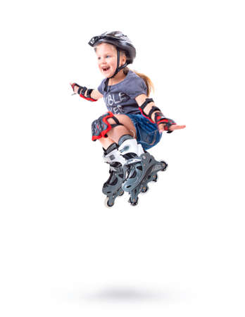 Five year old girl performs a roller skate trick Stock Photo