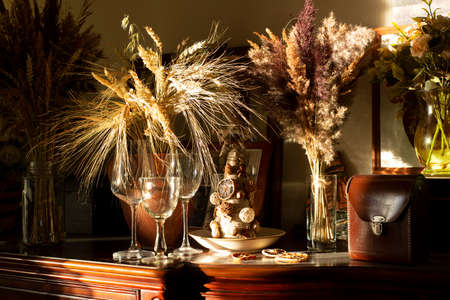 Victorian dresser, glassware and bouquets of dried field plants