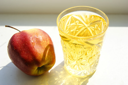 Apple juice in a glass photo