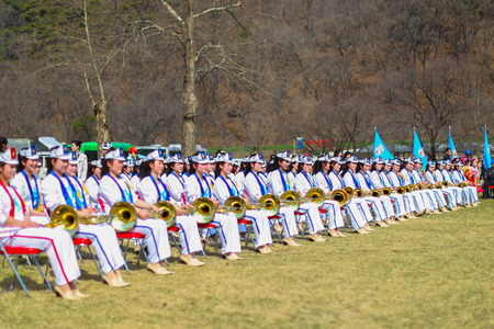 North Korea, Pyongyang, April 15, 2012 - South Gate of Taesŏng-san Fortress, the celebration in honor of the 100th anniversary of Kim Il Sung. Colorful presentation and games for guests. Female Brass Band