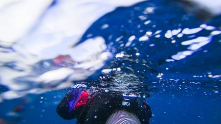 Diver diving in the ocean water wave