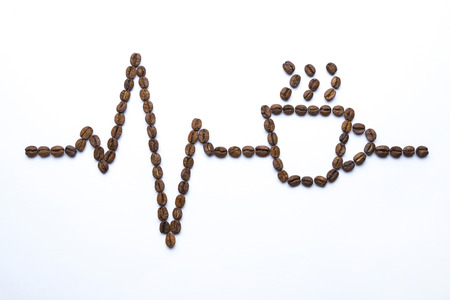 Cardiogram and cup drawn with coffee beans