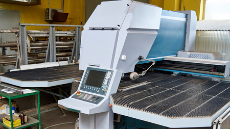 Automatic machine for cutting metal sheet in the workshop at the factory