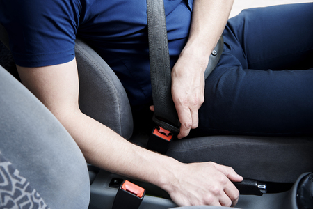 The driver of the car uses a safety belt.