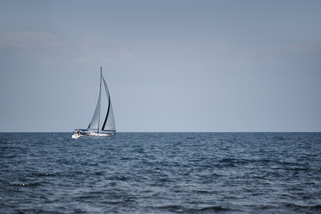 White yacht with sails in the open sea. 版權商用圖片