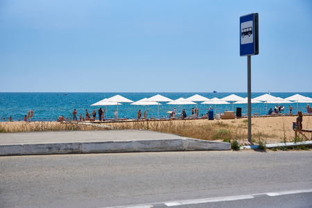 Theodosia, Crimea  Russia - July 04, 2018.Bus stop with a sign on the sea beach. 写真素材