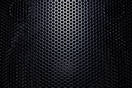 Black background protective grille with light. Foto de archivo