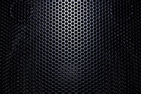 Rejilla protectora de fondo negro con luz.