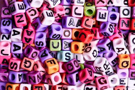 Colored cubes with English letters close-up.