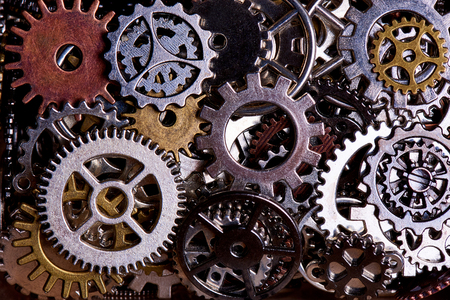 Background from various gears close-up. Stock Photo